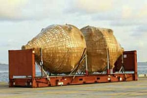 Oversized wrapped cargo sitting on a port dock