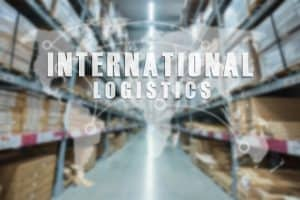International logistics written on a background of a warehouse aisle.